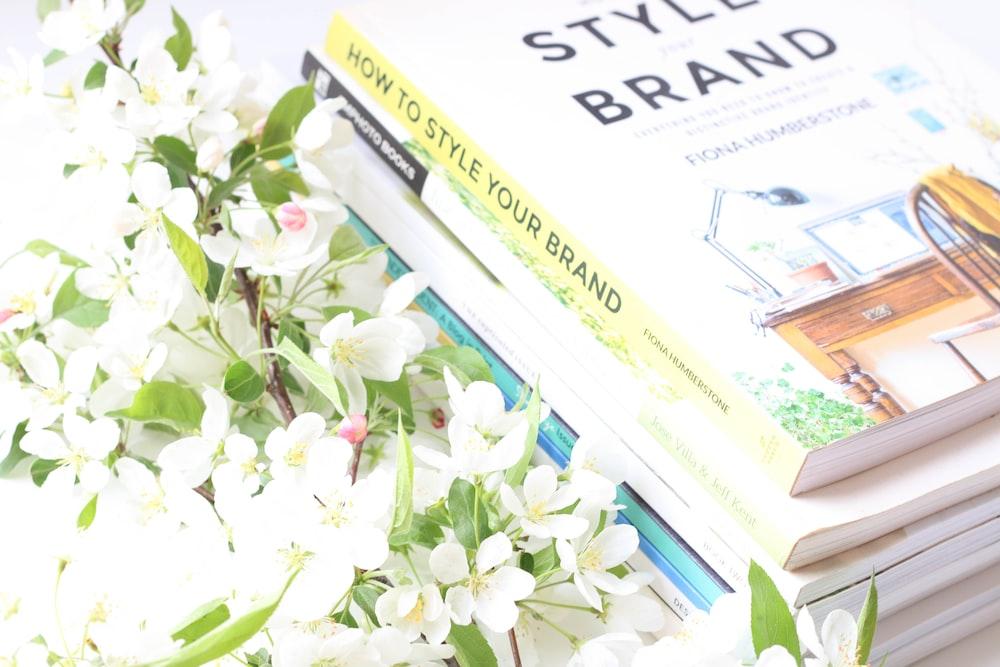 white flowers on white newspaper