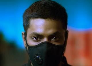 man wearing black mask