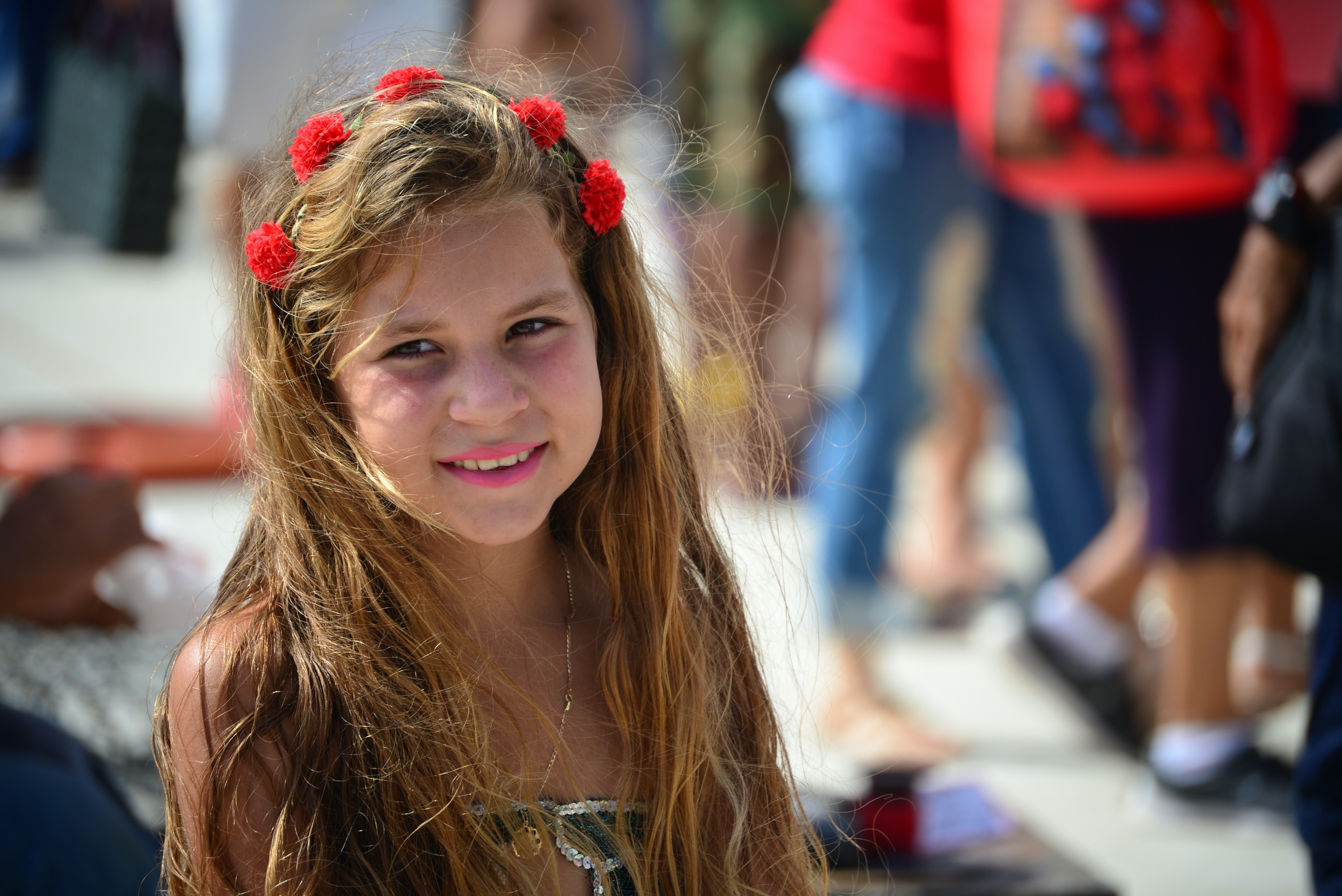 smiling girl with red flower headdress
