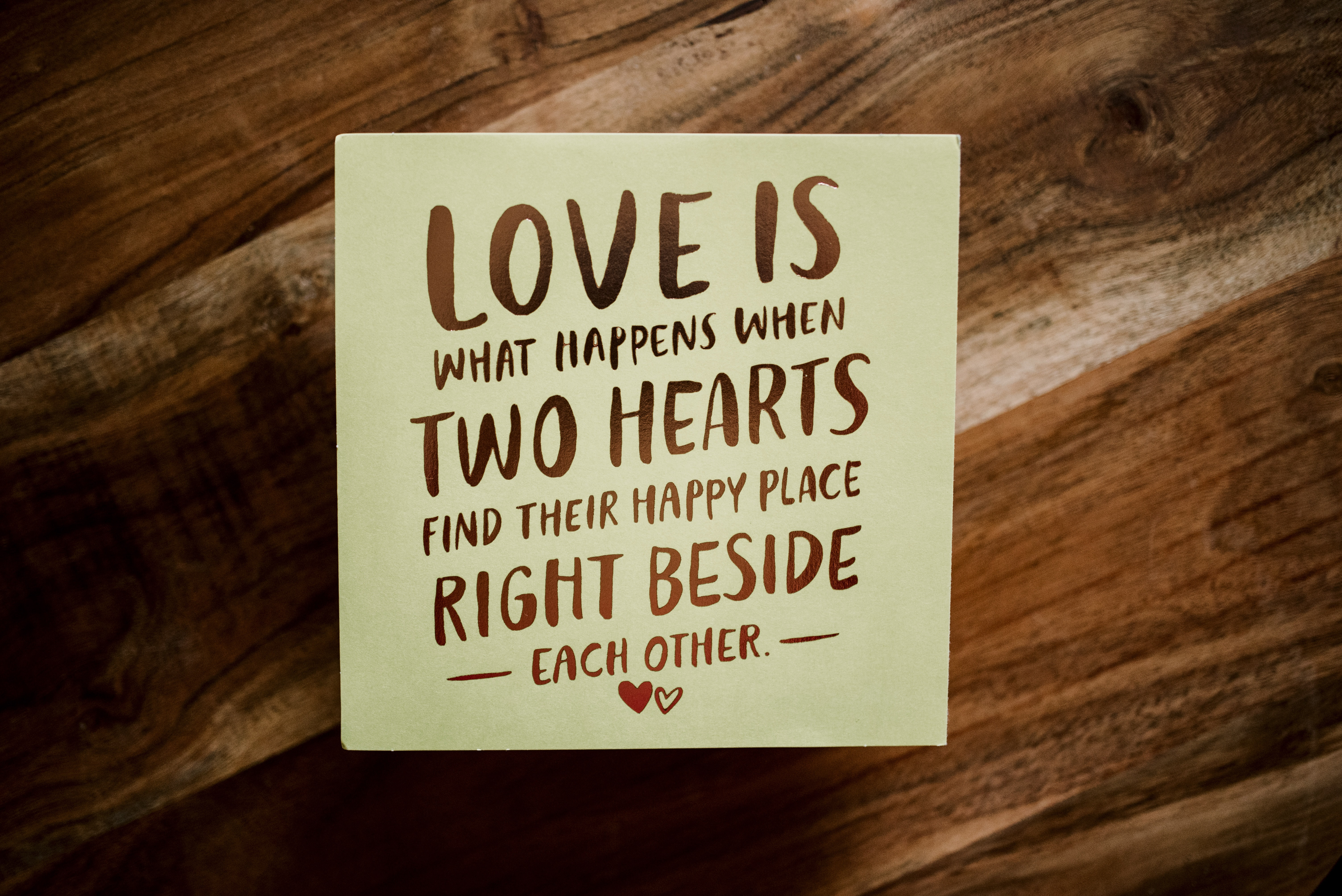 love is what happen when two hearts wall decor