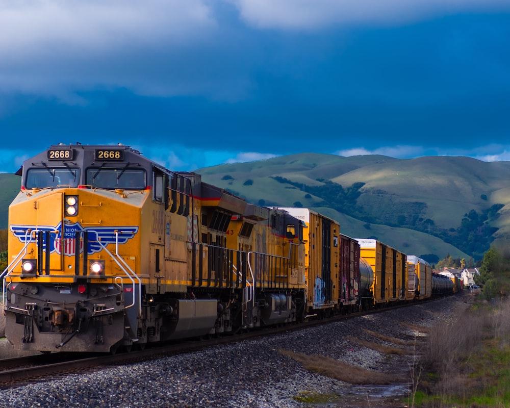 yellow and black train near mountain