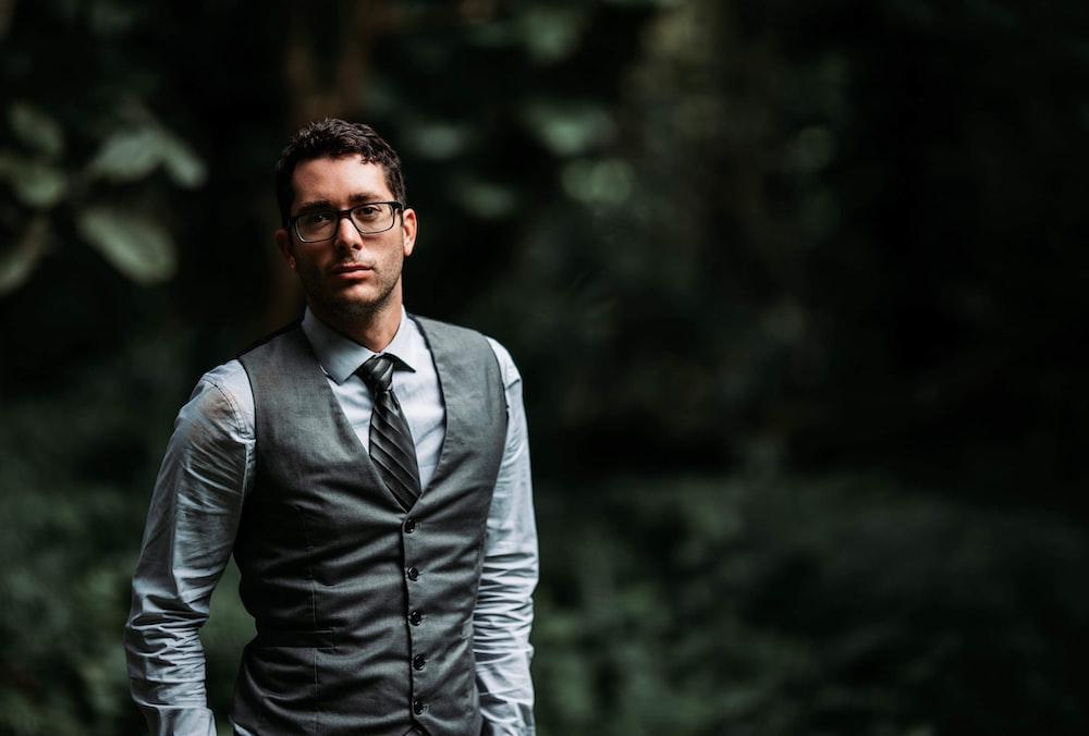 man wearing gray suit vest during daytime