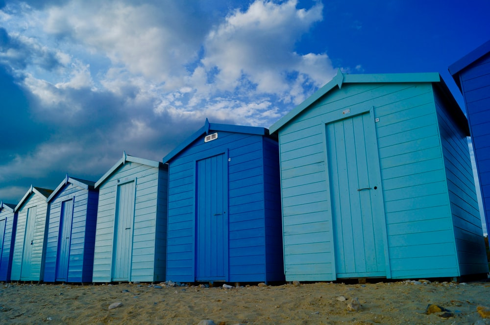 blue and white sheds under blue sky