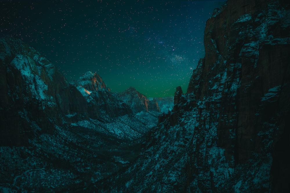 black mountain under clear night sky