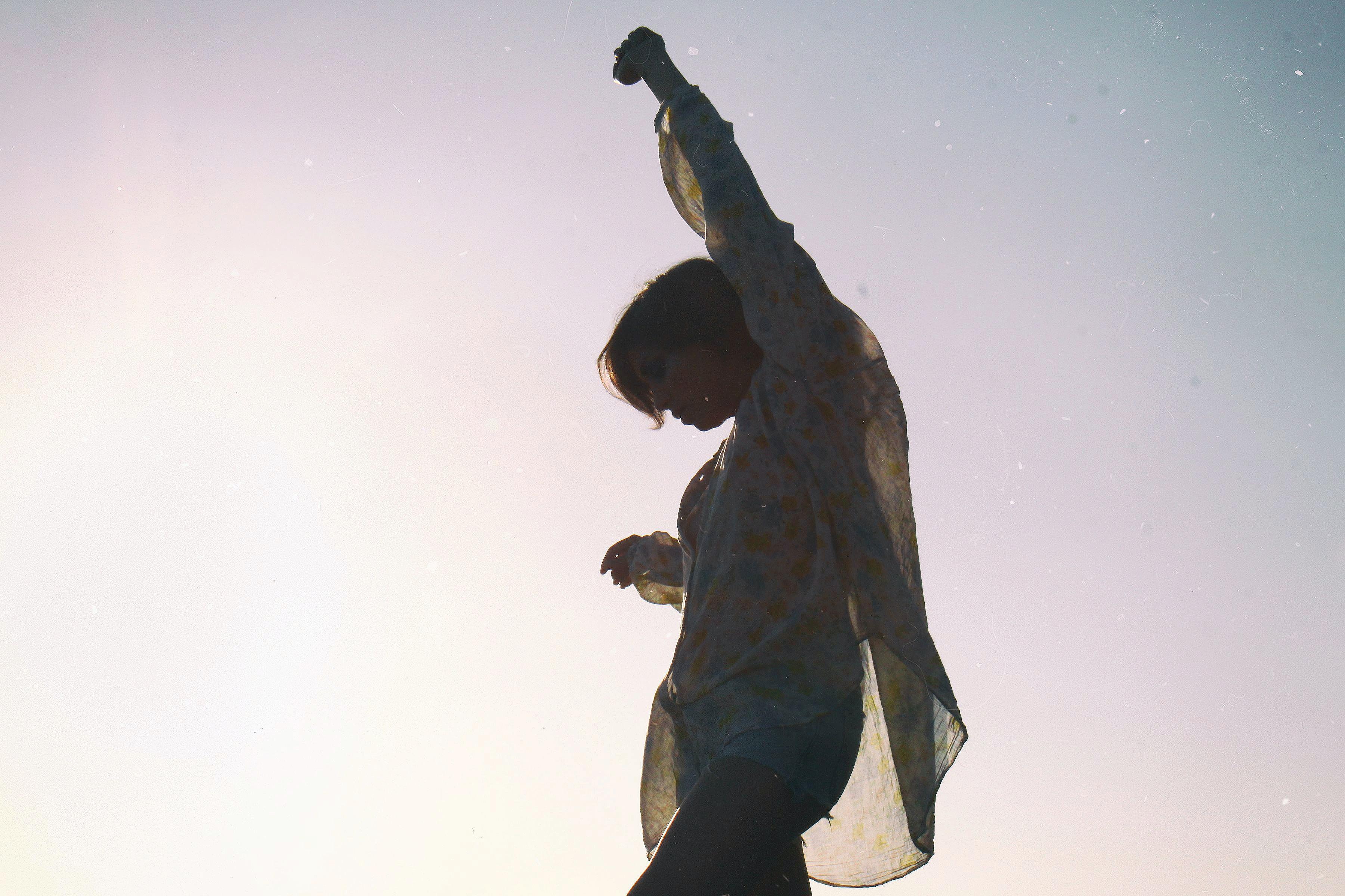 person raising left hand