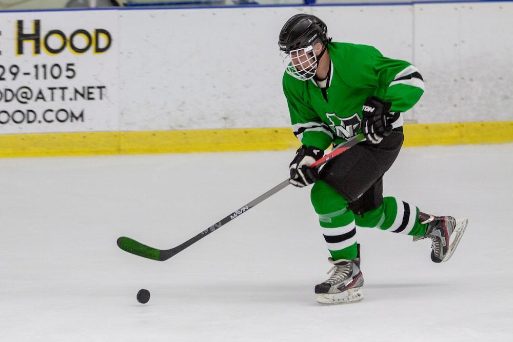 man in hockey gear playing hockey
