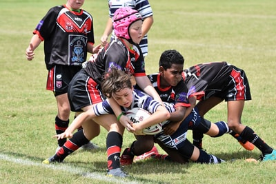 children playing football rugby teams background