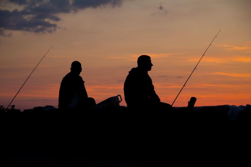 silhoette of man fishing