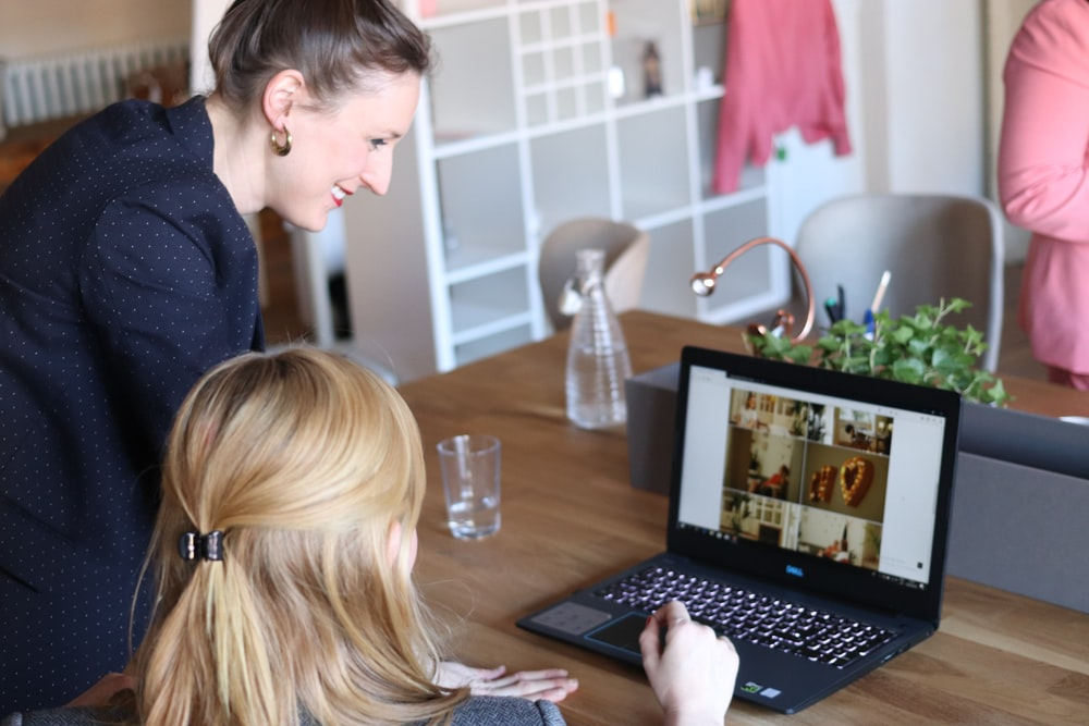 girl using black laptop computer