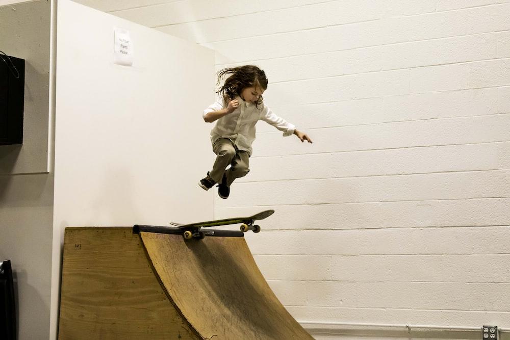 child playing skateboard at ramp