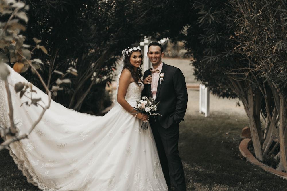 wedding couple taking photos outdoor