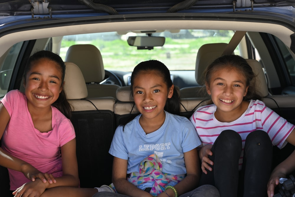 three girls in vehicle