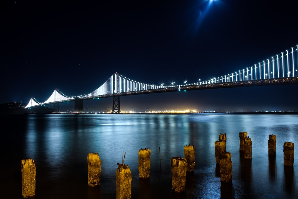 selective focus photography of lighted bridge during nighttime