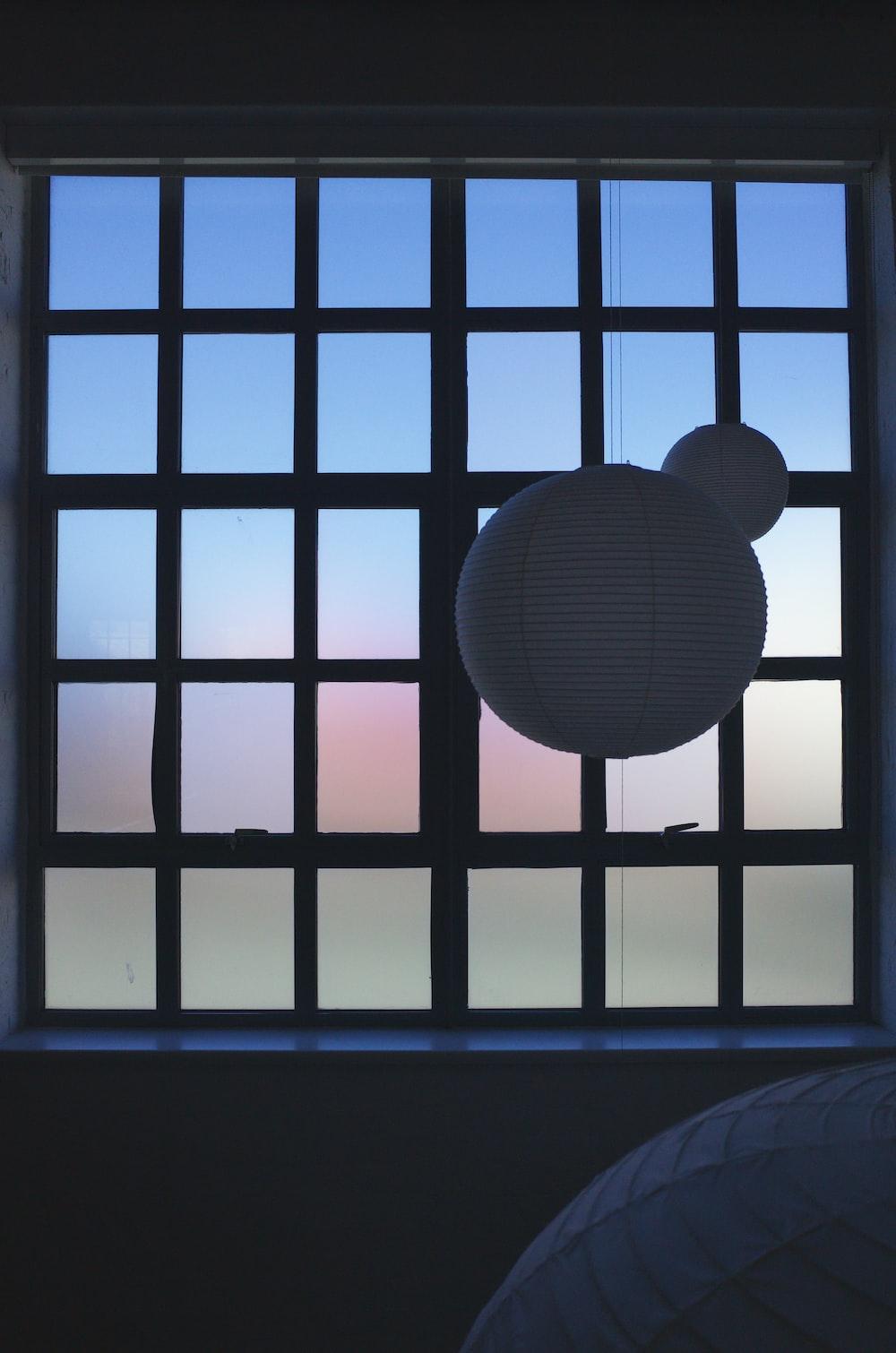 white lantern near window