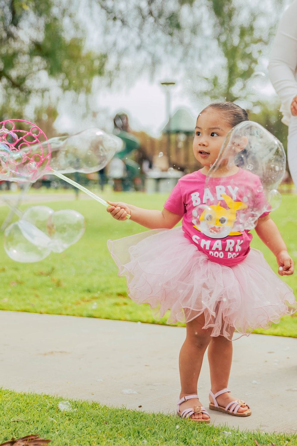 girl playing bubbles during daytime