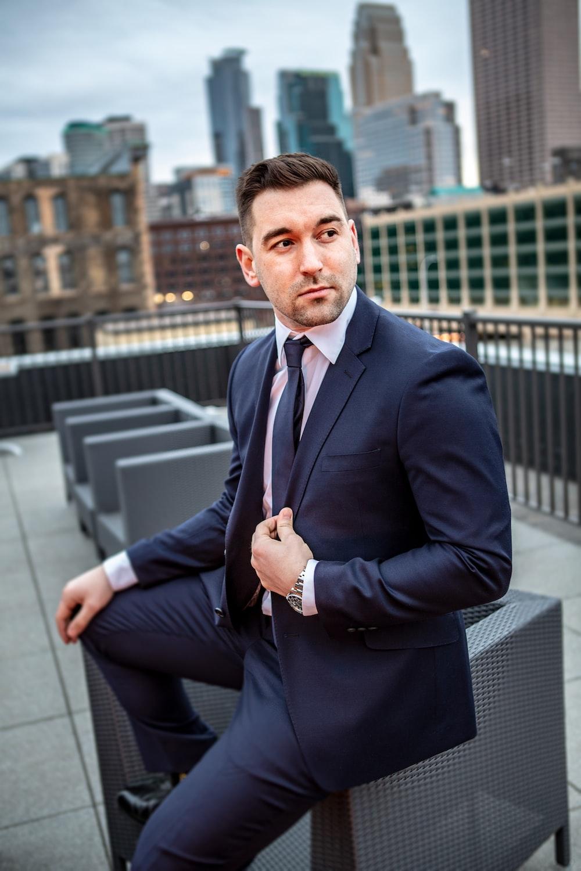 man in suit jacket sitting down