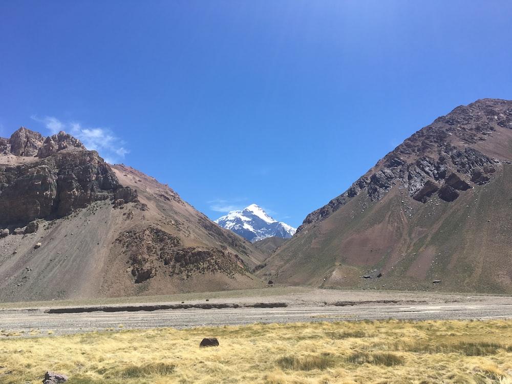 gray field beside mountain