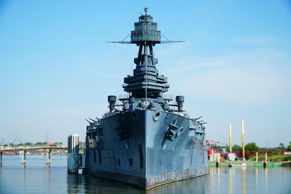 gray battleship on body of water during daytime