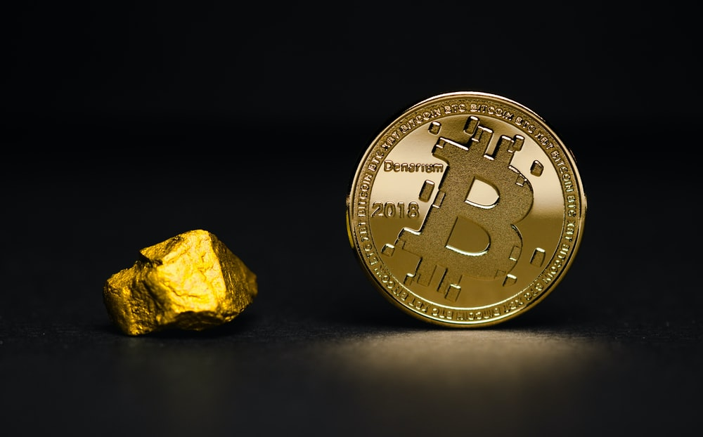 round gold-colored bit coin