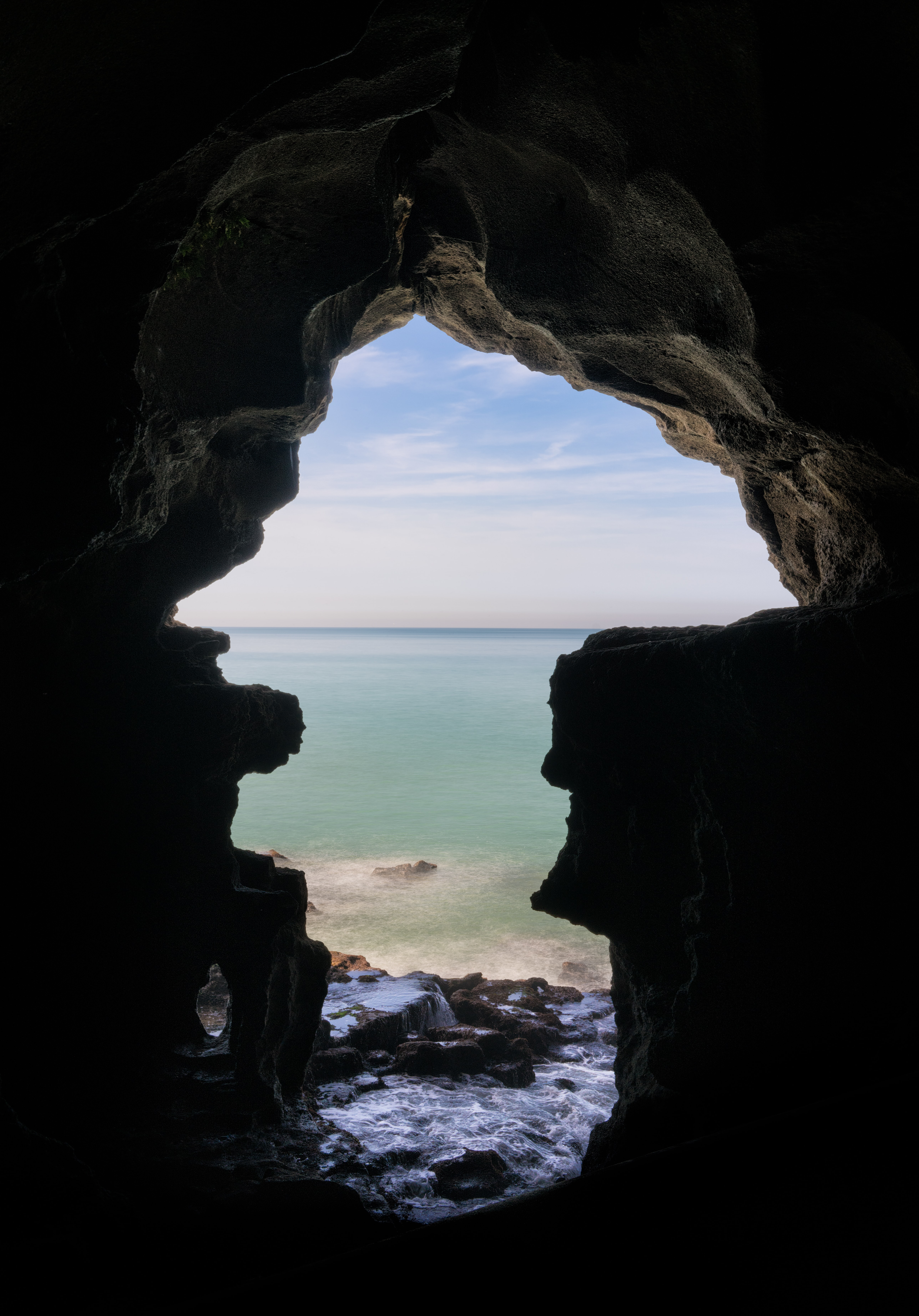 body of water near cave