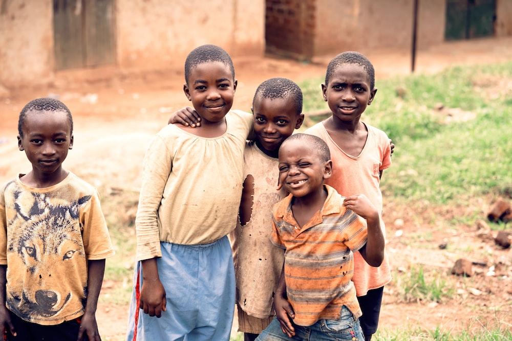 smiling boys wearing brown shirts