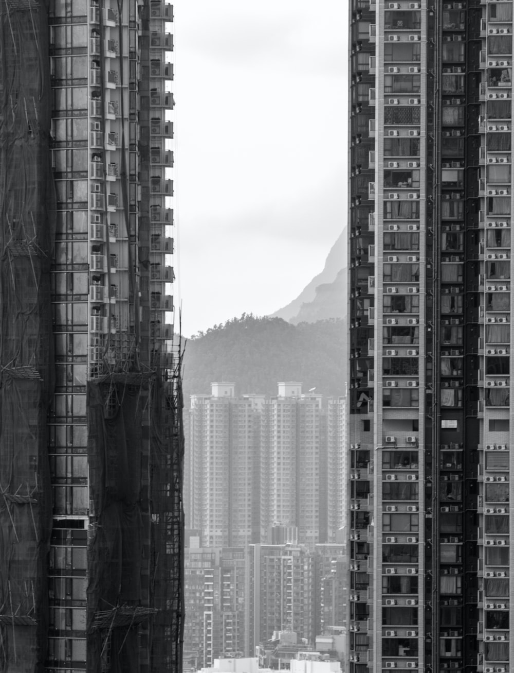 grayscale photography of high rise buildings
