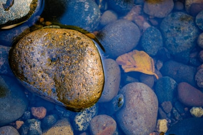 stones under body of water