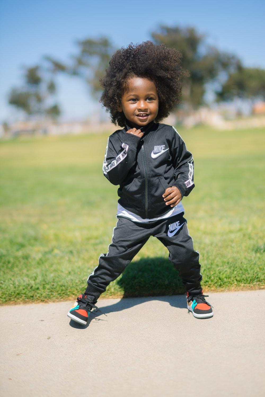 boy wearing black Nike track suit