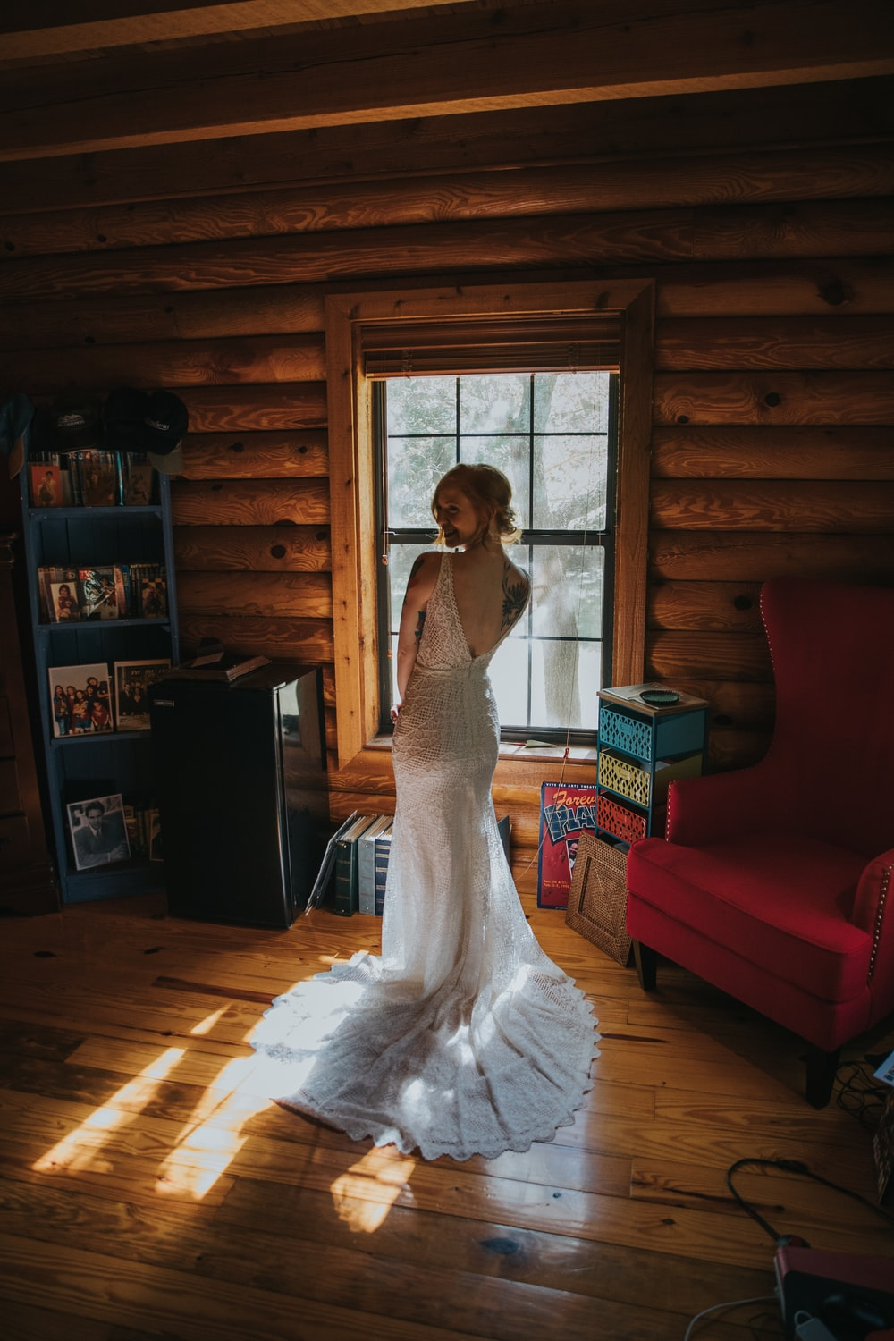 woman wearing white gown standing inside the house