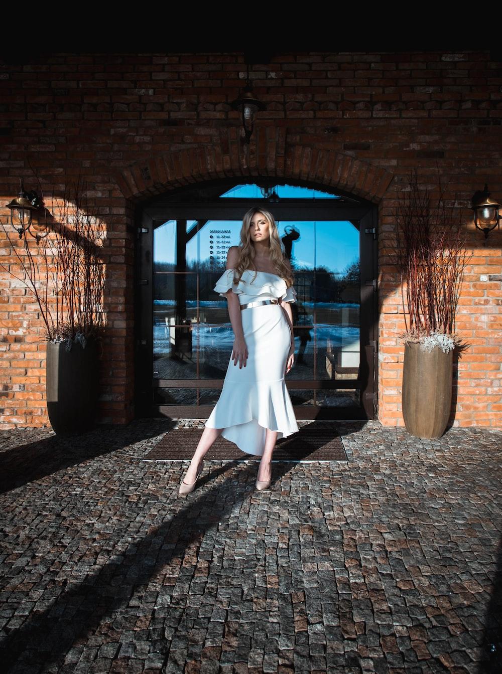 woman wearing white dress