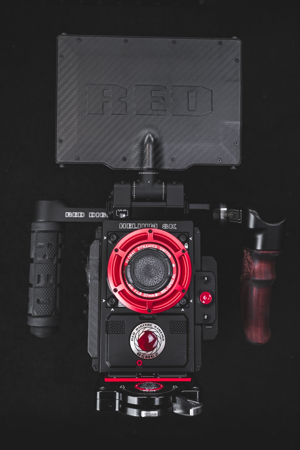 black and red Red video camera with stabilizer