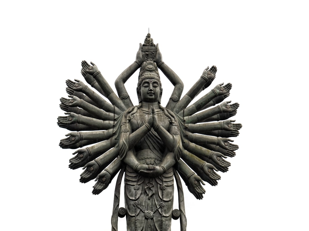 deity statue in grayscale photography