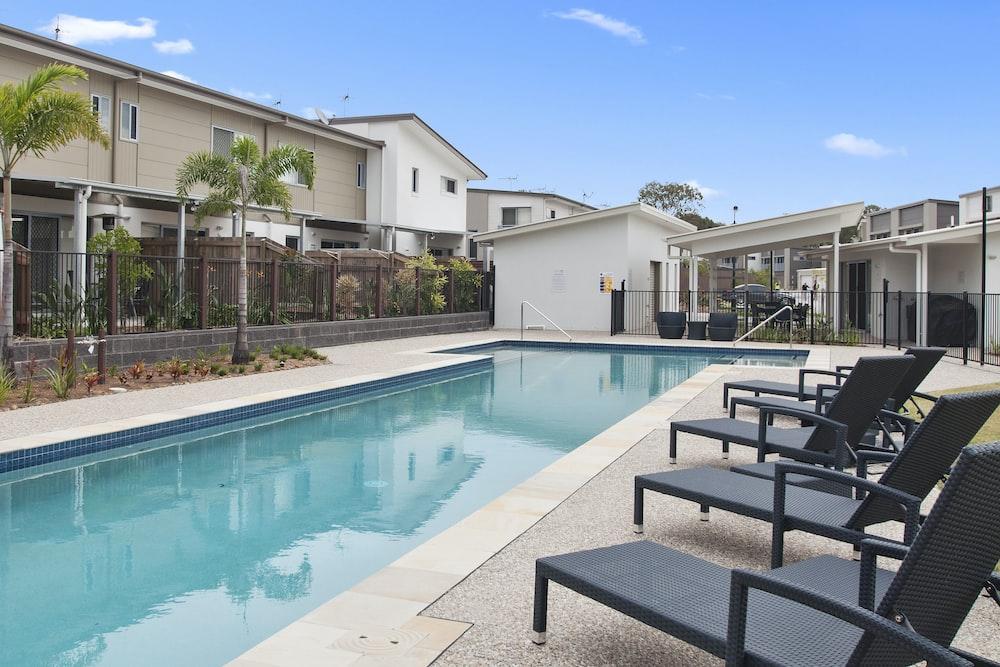 loungers near swimming pool