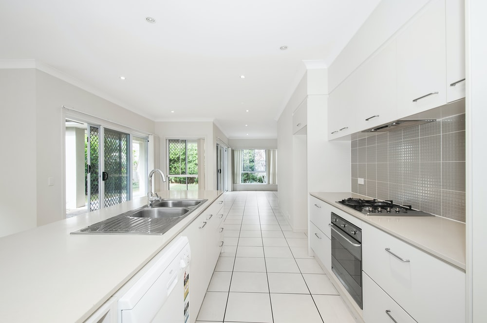 white wooden kitchen cupboards