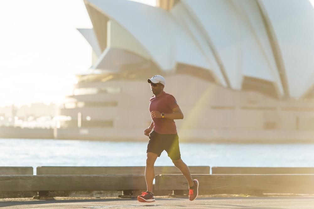 man running near Sydney Opera House
