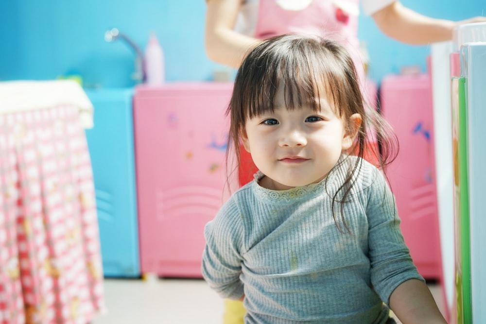 toddler wears blue long-sleeved shirt