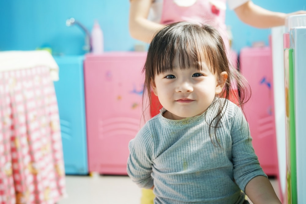 toddler wears blue long-sleeved shirt