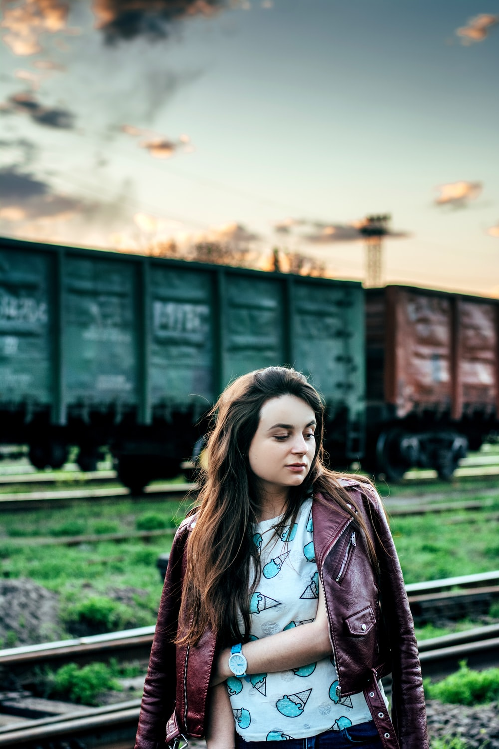 woman standing near train on selective focus photography