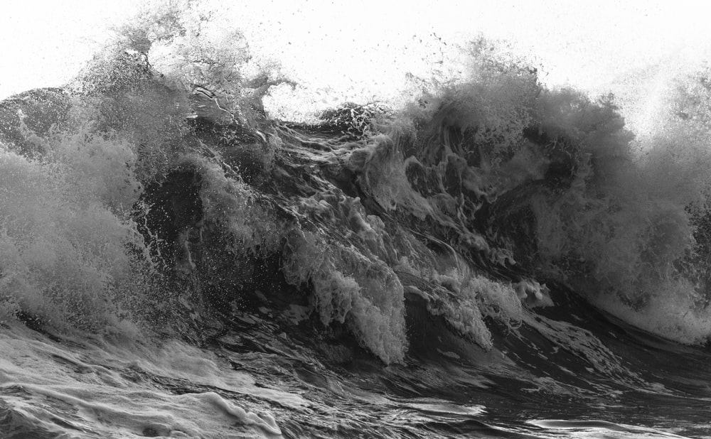 grayscale photography of water wave