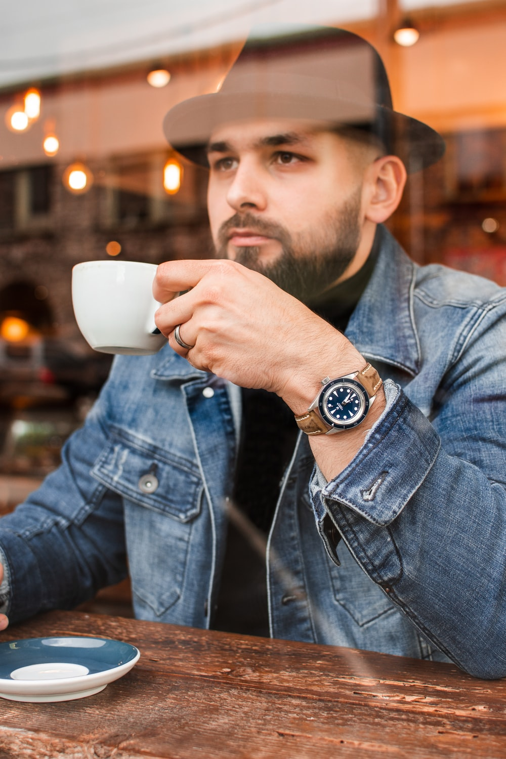 man drinking coffee in room
