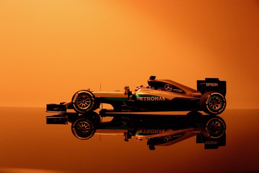 yellow and black Petronas formula 1 car