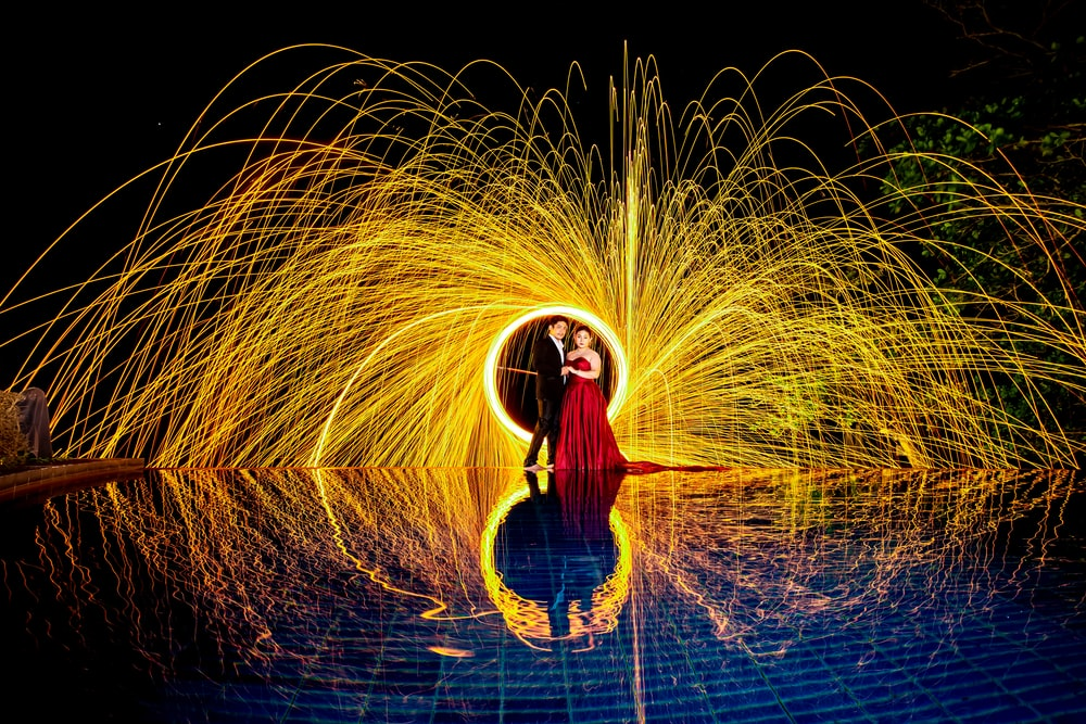 man and woman near steel wool photography