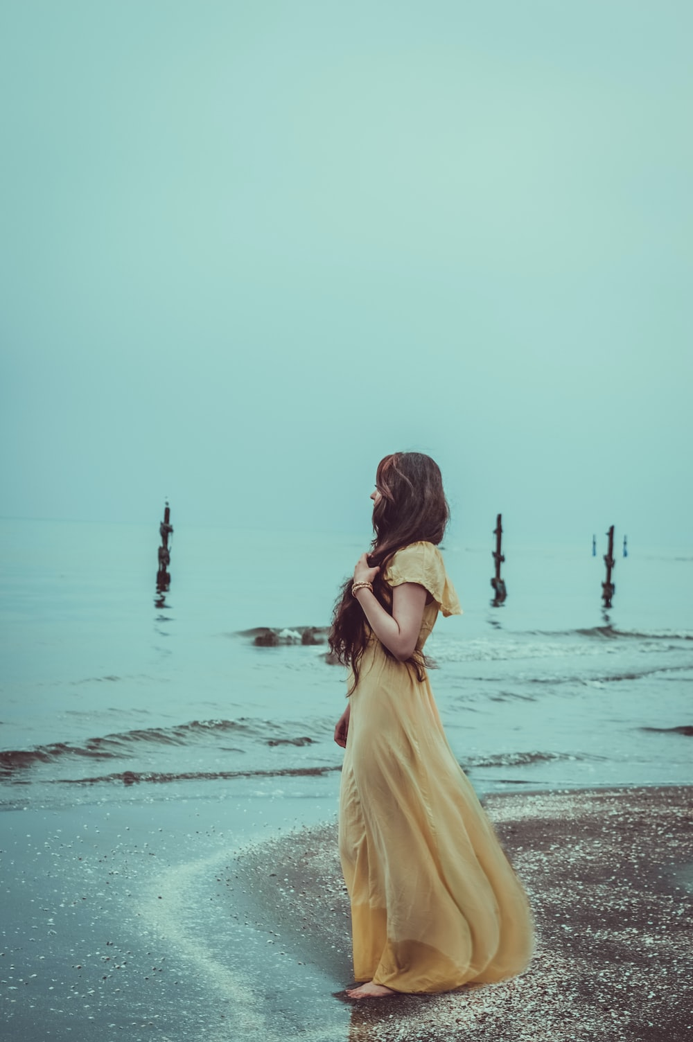 woman standing on shore
