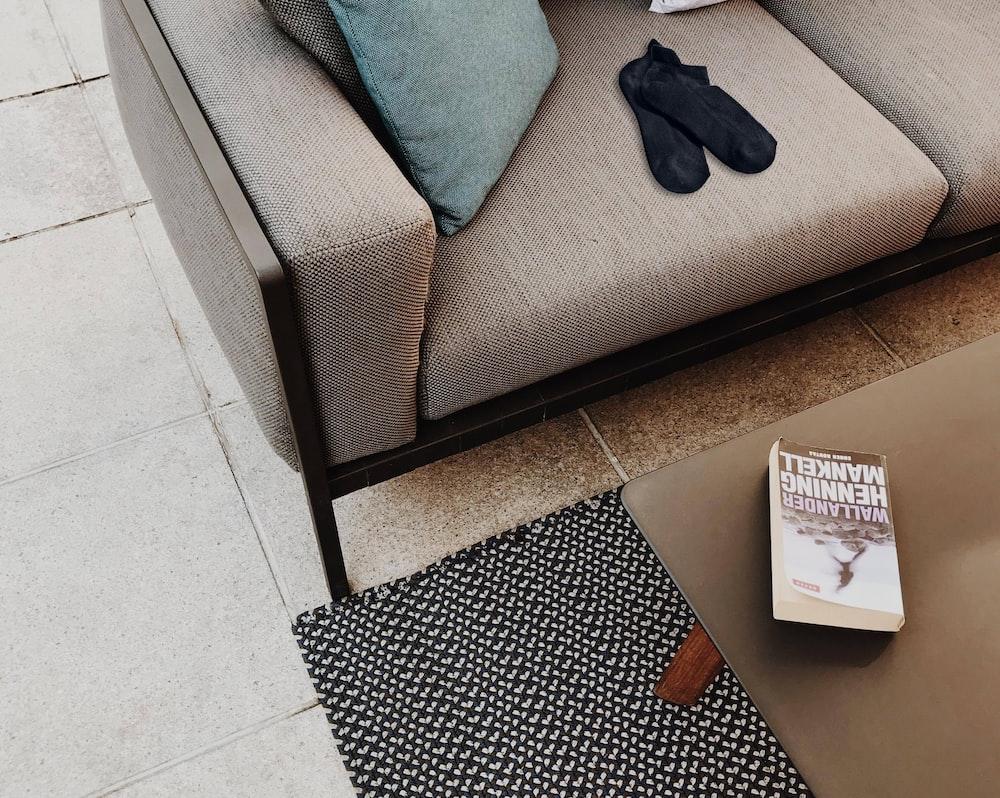 pair of black socks on gray sofa