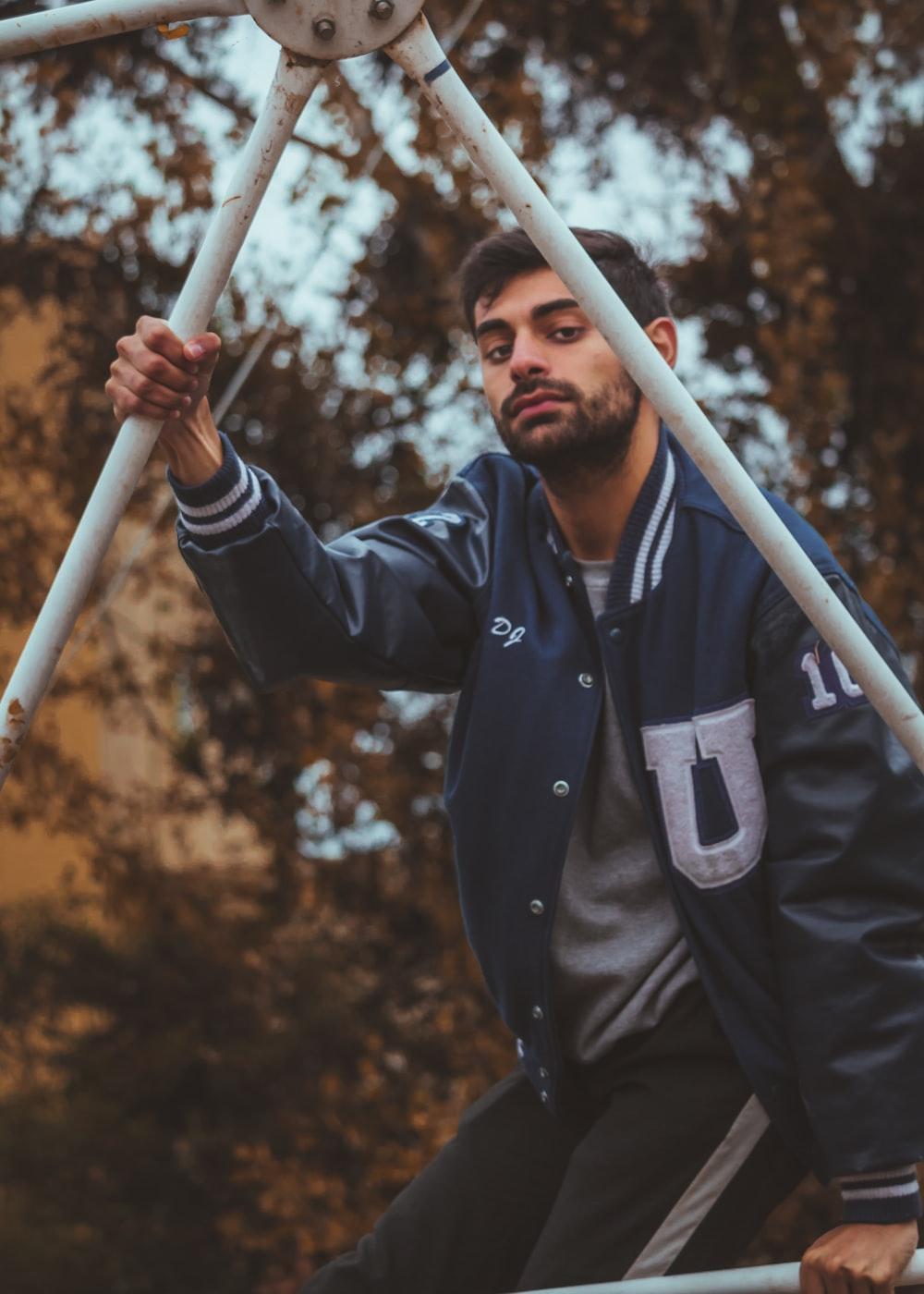 man holding white metal frame during daytime