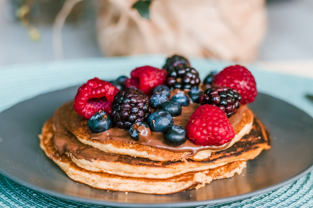 pancake with raspberries and blue berries toppings