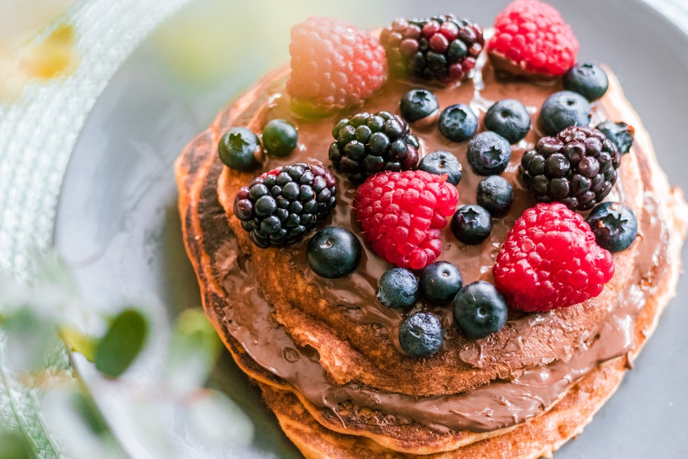 pancake with assorted berries in plate