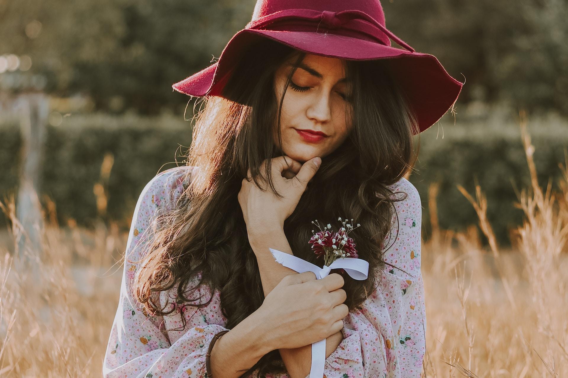 woman wearing brown floral long-sleeved dress