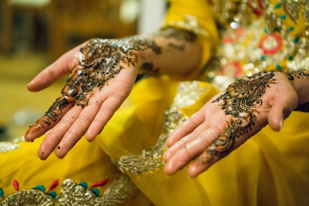 Pakistani indian Mendhi night. Bride to be with yellow dress and mendhi.