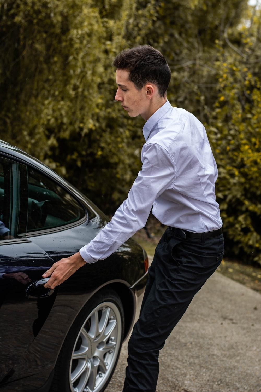 man holding vehicle door